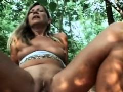 Busty blonde shares her senior cunt outdoor