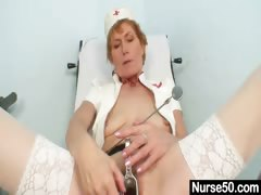 Old mom self exam on gynochair with speculum