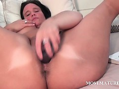 Nasty mature toys her hungry pussy