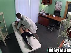 Brunette gets fingered while sucking her doctors cock