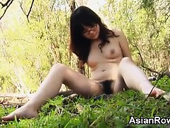 Asian Teen With Glasses Strips Outsde