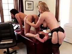 Blonde and brunette lesbians in hot act