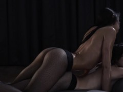Two horny girls having intercourse on red couch