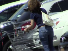 Hidden camera catches a woman in tight jeans on a parking l