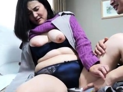 Asian MILF Spanks Herself As She Rides Fat Cock