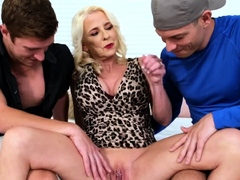 Horny mature gets laid with two rough studs